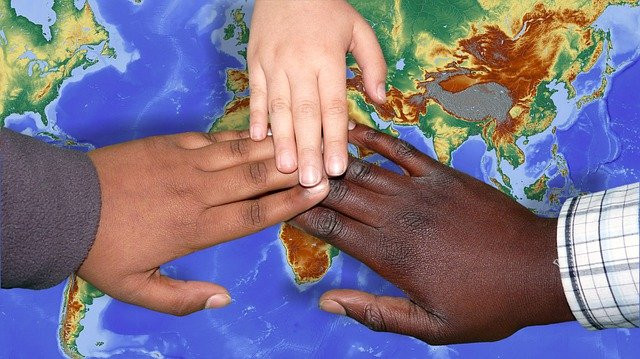 Children of different races touching hands. We were all made in the image of God.