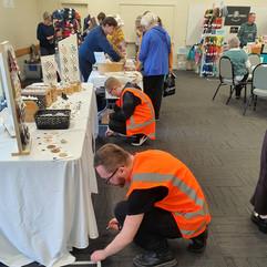 Volunteers removing masking tape