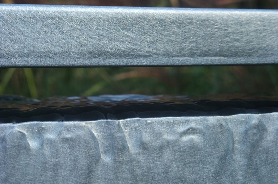 Mur d'eau zinc à débordement