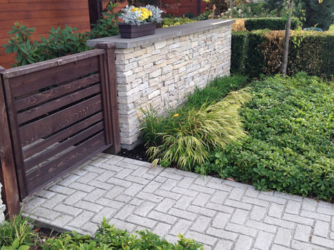 Front yard planting and fence design at the Breeze townhome. Client: Adera Developments Part of the landscape design as Project Manager for Jonathan Losee Ltd.