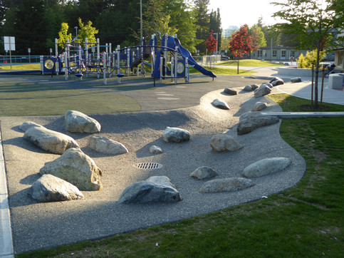 Funky concrete water channel design at Norma Rose Point Elementary Client: Vancouver School District. Part of the overall site design as Project Manager for Jonathan Losee Ltd.