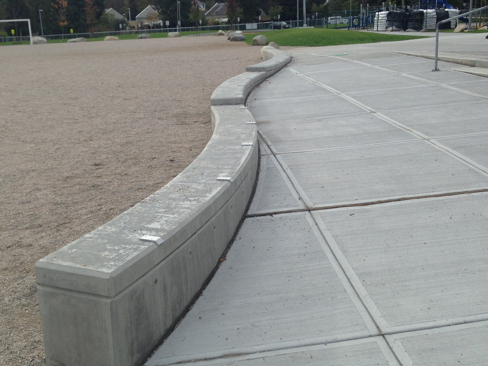 Funky concrete wall design at Norma Rose Point Elementary Client: Vancouver School District. Part of the overall site design as Project Manager for Jonathan Losee Ltd.