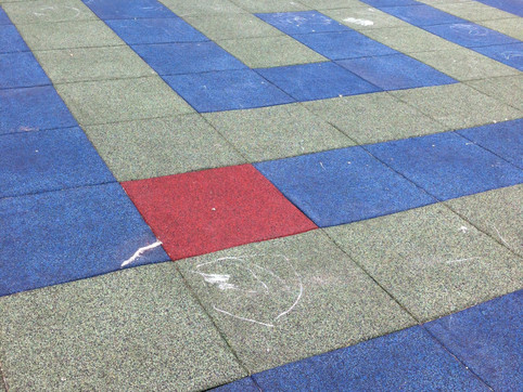 Labyrinth design with rubber playground surfacing at Emery Barnes Park Phase 2. Client: Vancouver Parks Board. Part of the overall site design as Project Manager for Jonathan Losee Ltd.