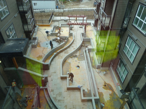 Water feature design at the Ultimatownhome. Client: Adera Developments Part of the landscape design as Project Manager for Jonathan Losee Ltd.