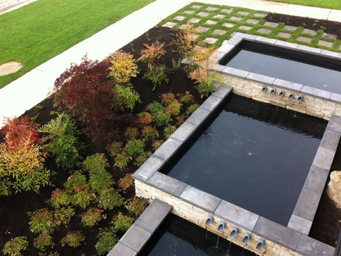 Water featureand planting design at the Breeze townhome. Client: Adera Developments Part of the landscape design as Project Manager for Jonathan Losee Ltd.