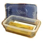 A plastic container for sharpening stones