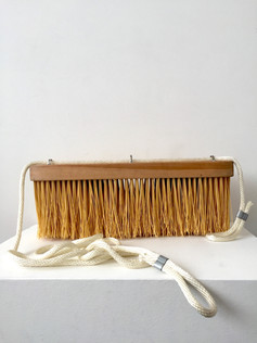 """A Hold Each 2017 bristles, ash, nylon rope, steel 8"""" x 20.5"""" x 5""""  Private Collection"""