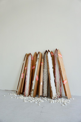 "Handle With Care (config. 1) 2019 cardboard, picket fence, packing material  40"" x 5"" x 6"" (each box) PUR"