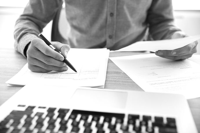 businessman-checking-documents-table_edited.jpg