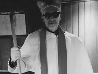 Holy smoke!  Bishop Ken blesses the Village Inn