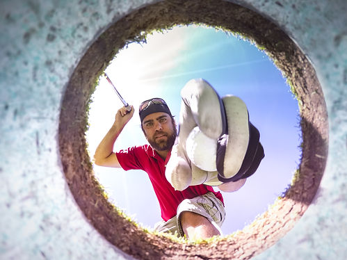 Golfer picking a ball out of the hole