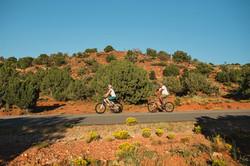 2 Bikers against Red Hillside_Horz_B