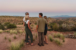 4 people standing with views in background_Horz_B