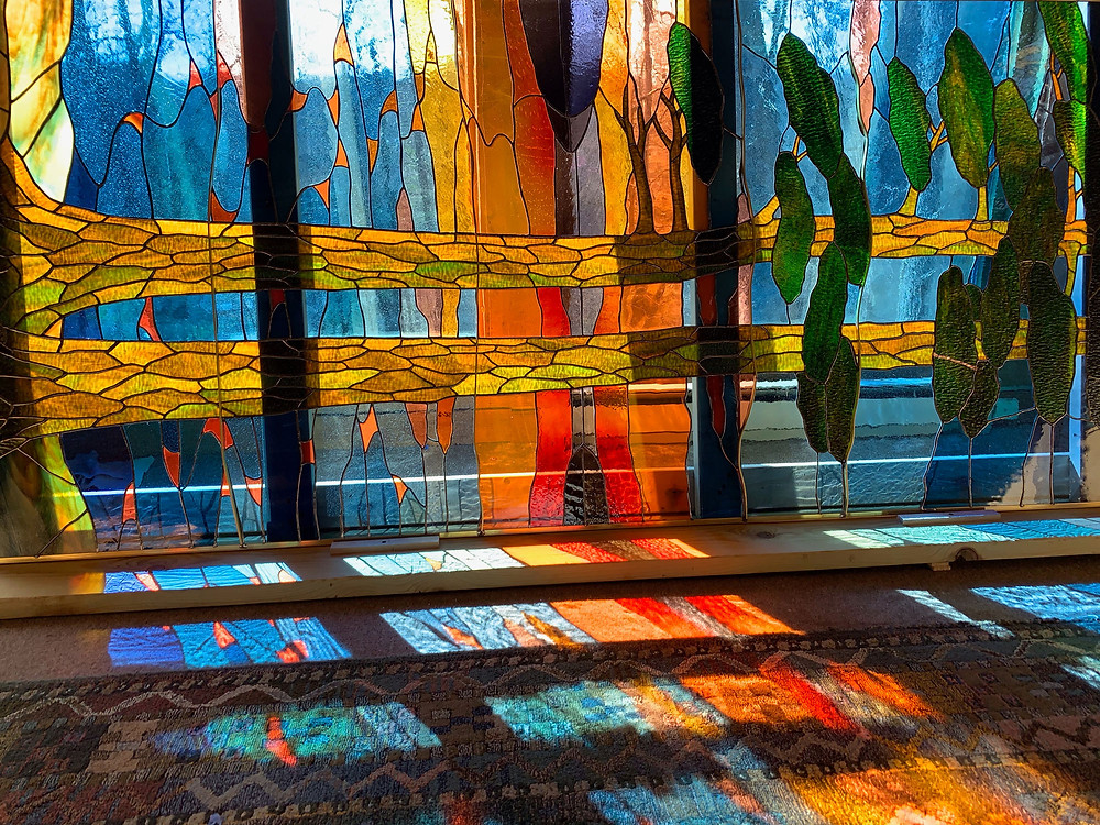 stained glass window with light shining through