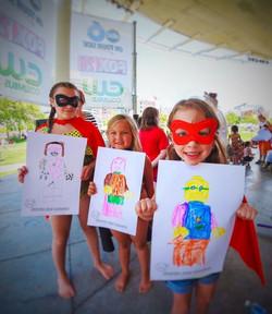 3_kids super costume gals on stage