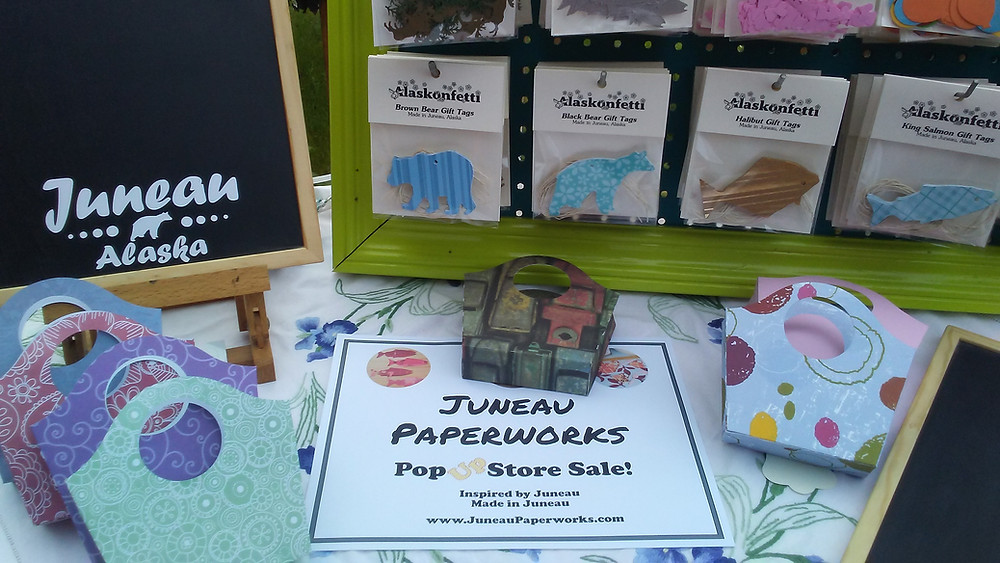 Gift tags, gift bags, and a sign for Juneau Paperworks' Pop Up Store