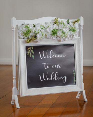 White floral sign  $20