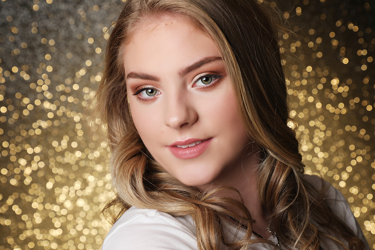 teen model makeover photoshoot gold sparkle background