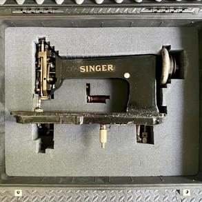 Singer 114w103 in it's travel case.