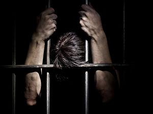 Fugitive behind bars