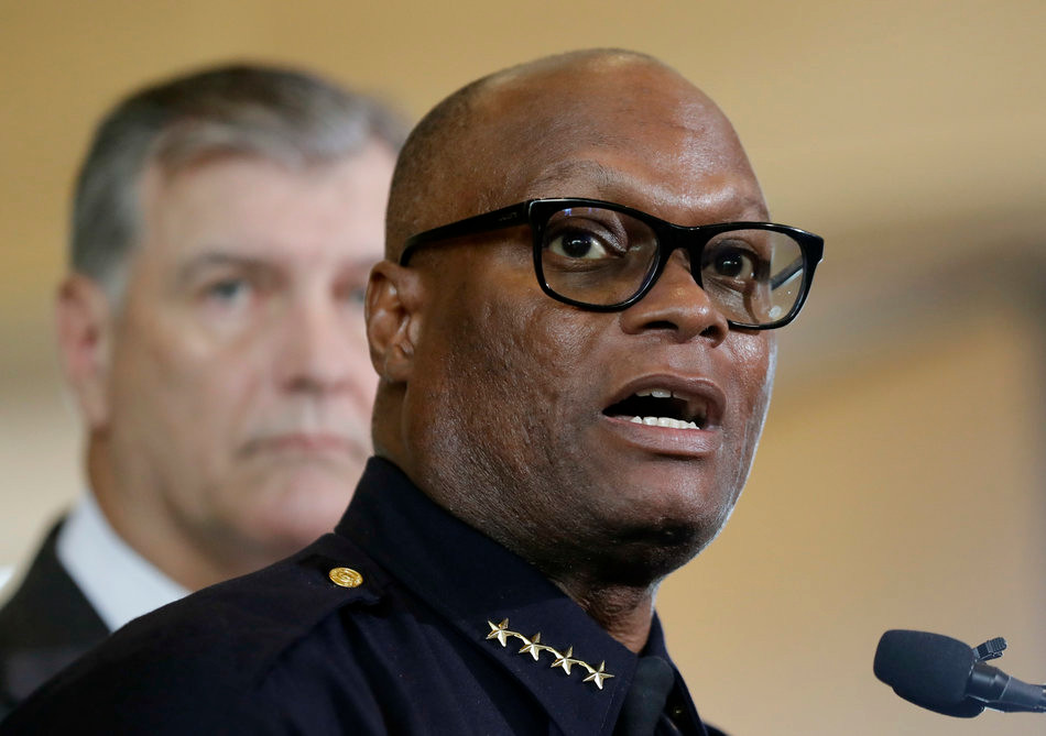 Dallas police Chief David Brown, front, and Dallas Mayor Mike Rawlings, talk with the media during a news conference Friday. (Eric Gay/AP)