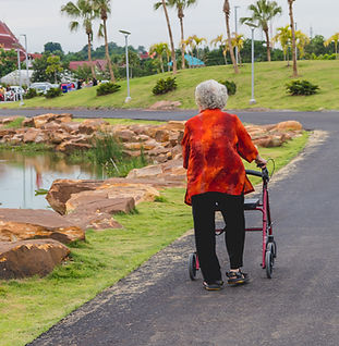 Older womna walking with wheeled frame