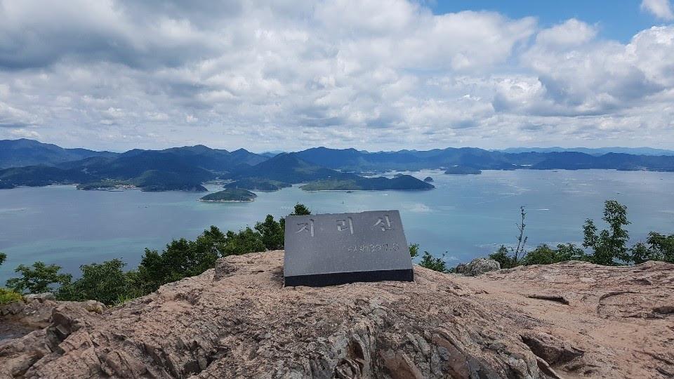 Peak overlooking sea and clouds