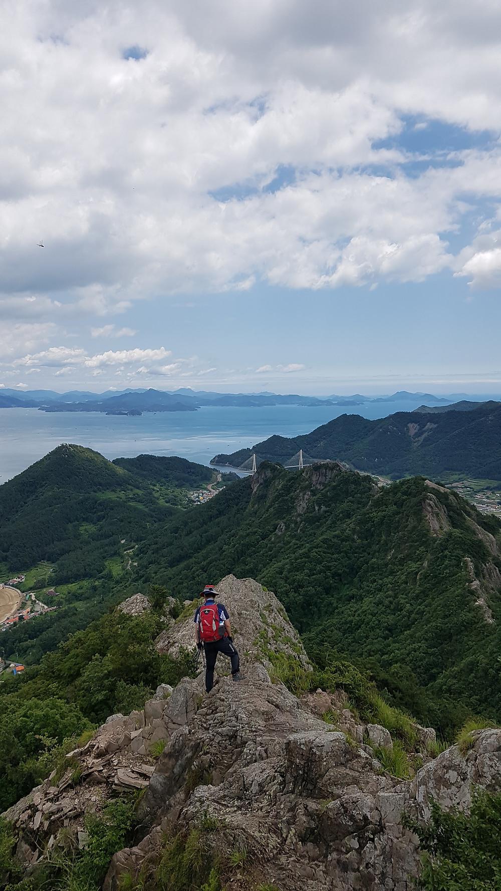 Man hiking on a rocky ridge