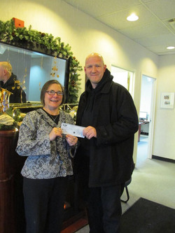 Gail receiving Steel Workers union cheque.jpg