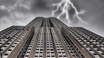 Lightning behind building