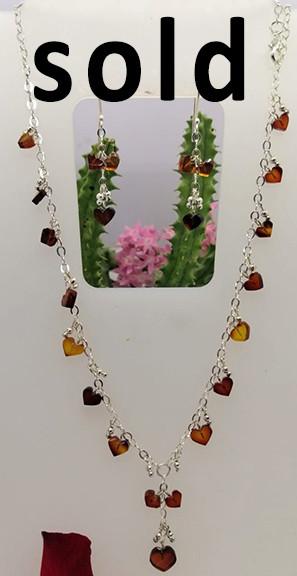 SOLD-Red amber heart shaped choker on a silver chain $950 pesos plus shipping (mas envio)