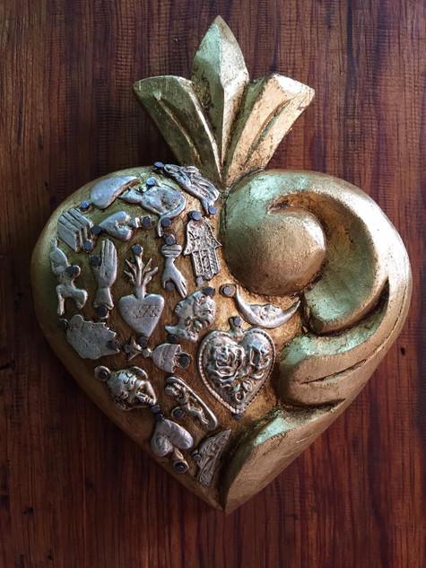 Heart decorated with milagros $380 pesos plus shipping (mas envio)