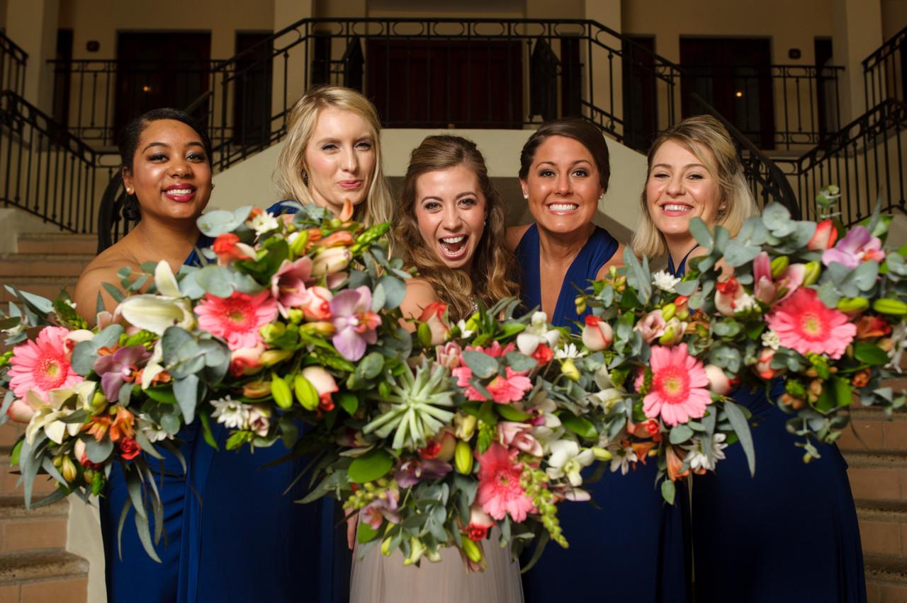 Bridesmaids show off  tropical bouquets at Villa Tranquila in Hacienda Pinilla