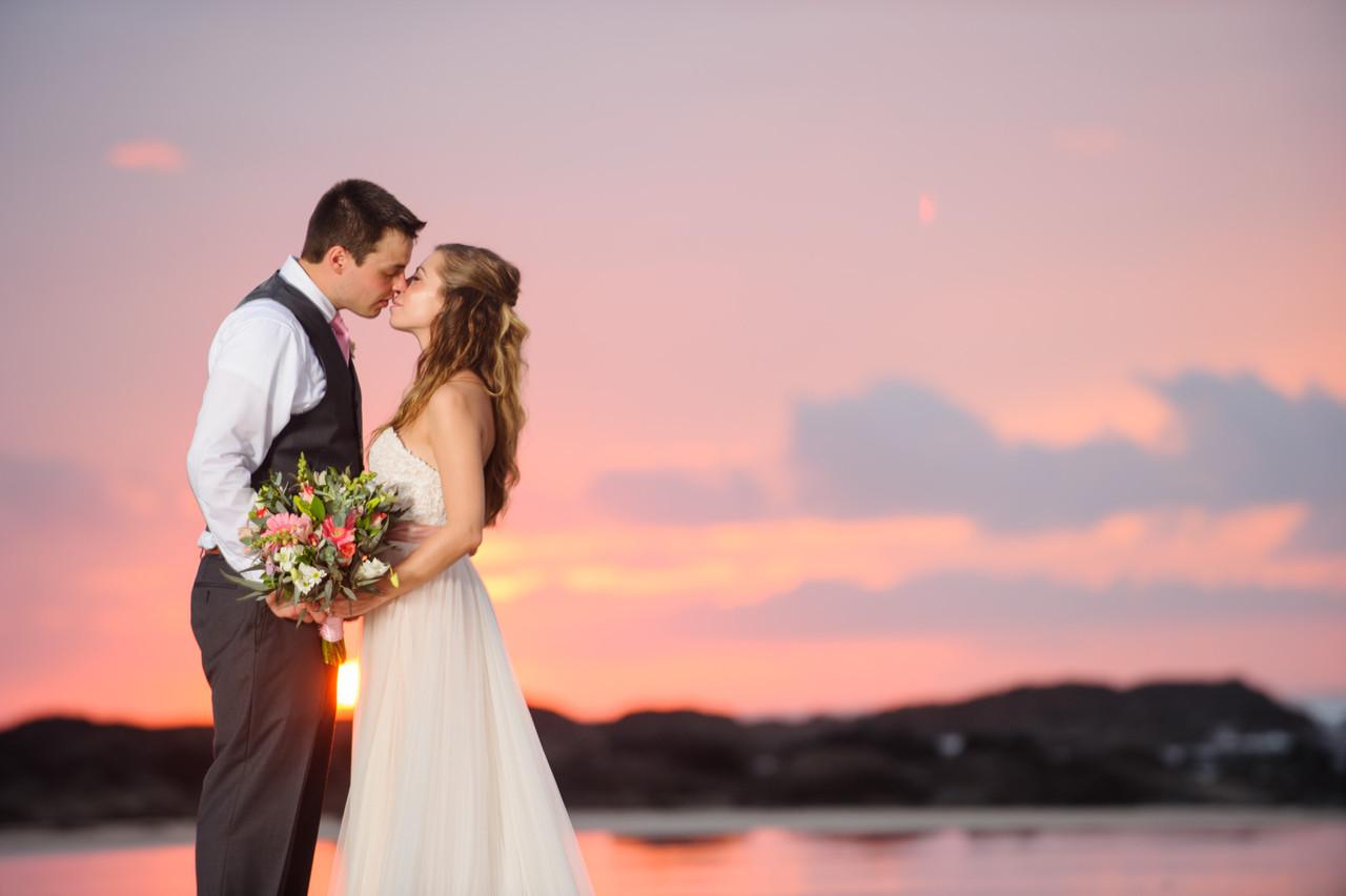 Sharing a kiss at sunset   in Hacienda Pinilla