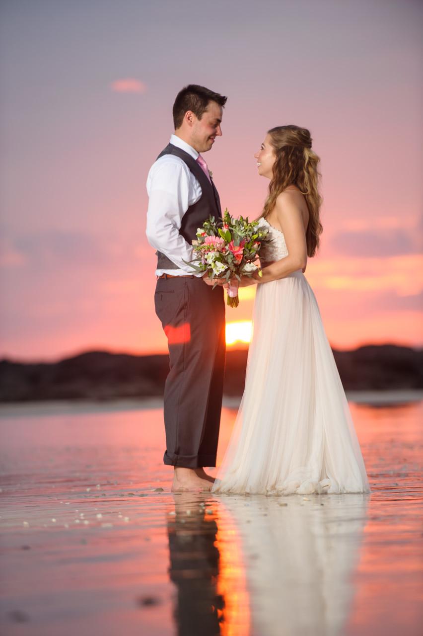 Bride and groom enjoy the sunset in Hacienda Pinilla