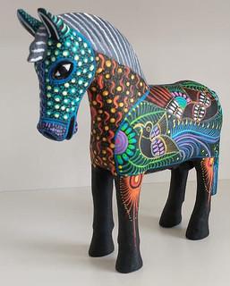 Hand-carved Wood Horse with Nahual Paintings $1,500 pesos plus shipping (mas envio) Medium: 20 cm long x15 cm high $1000 plus shipping (mas envio) Small: 15 cm long x10 cm high $400 pesos plus shipping (mas envio)