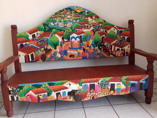 Living room set: carved village motif; sofa 3 people, armchair 2 people, single chair and coffee table $19,500 pesos plus shipping (mas envio)