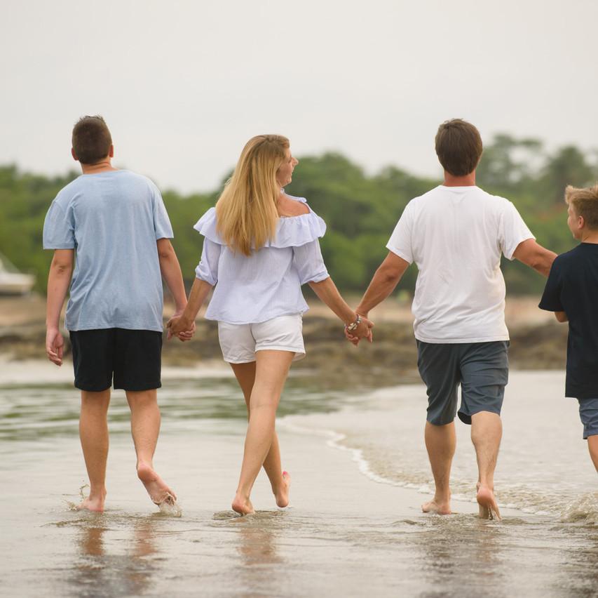 Family beach stroll at Tamarindo Diria