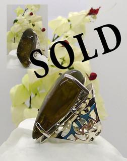 SOLD--Green Amber Ring $1,600 pesos plus shipping (mas envio)