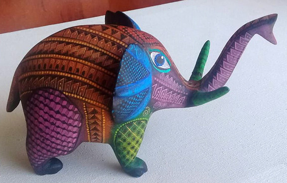 Hand-carved Alebrije $2500 pesos plus shipping (mas envio)