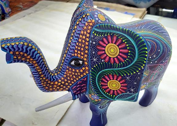 Hand-carved Wood Elephant with Nahual Paintings $1,400 pesos plus shipping (mas envio) 15 cm long x10 cm high $400 pesos plus shipping (mas envio)