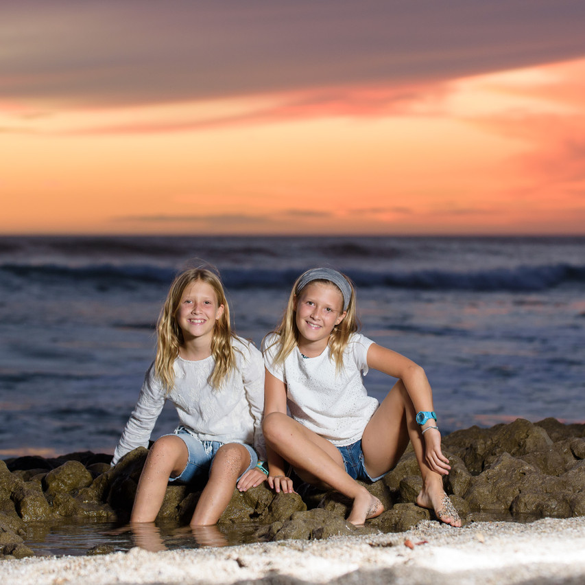 Sisters playing in the tide pools at Playa Langosta