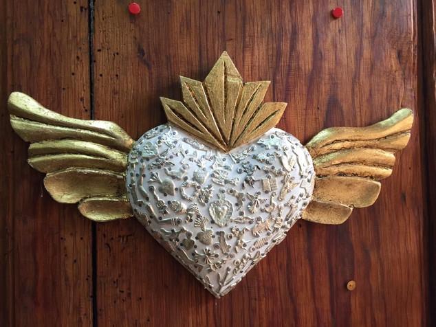 Heart decorated with milagros $750 pesos plus shipping (mas envio)