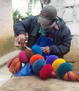 Feliciano working on the borlas (pompons)