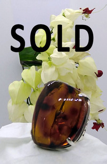 SOLD--Red Marbled Amber Ring $1,200 pesos plus shipping (mas envio)
