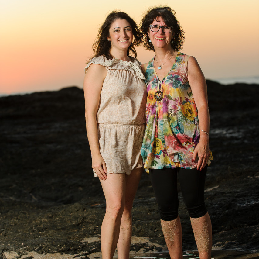 Mom and daughter watch the sunset together on Langosta Beach