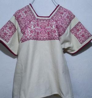 Huipil with rose/maroon embroidery $1400 pesos plus shipping (mas envio)