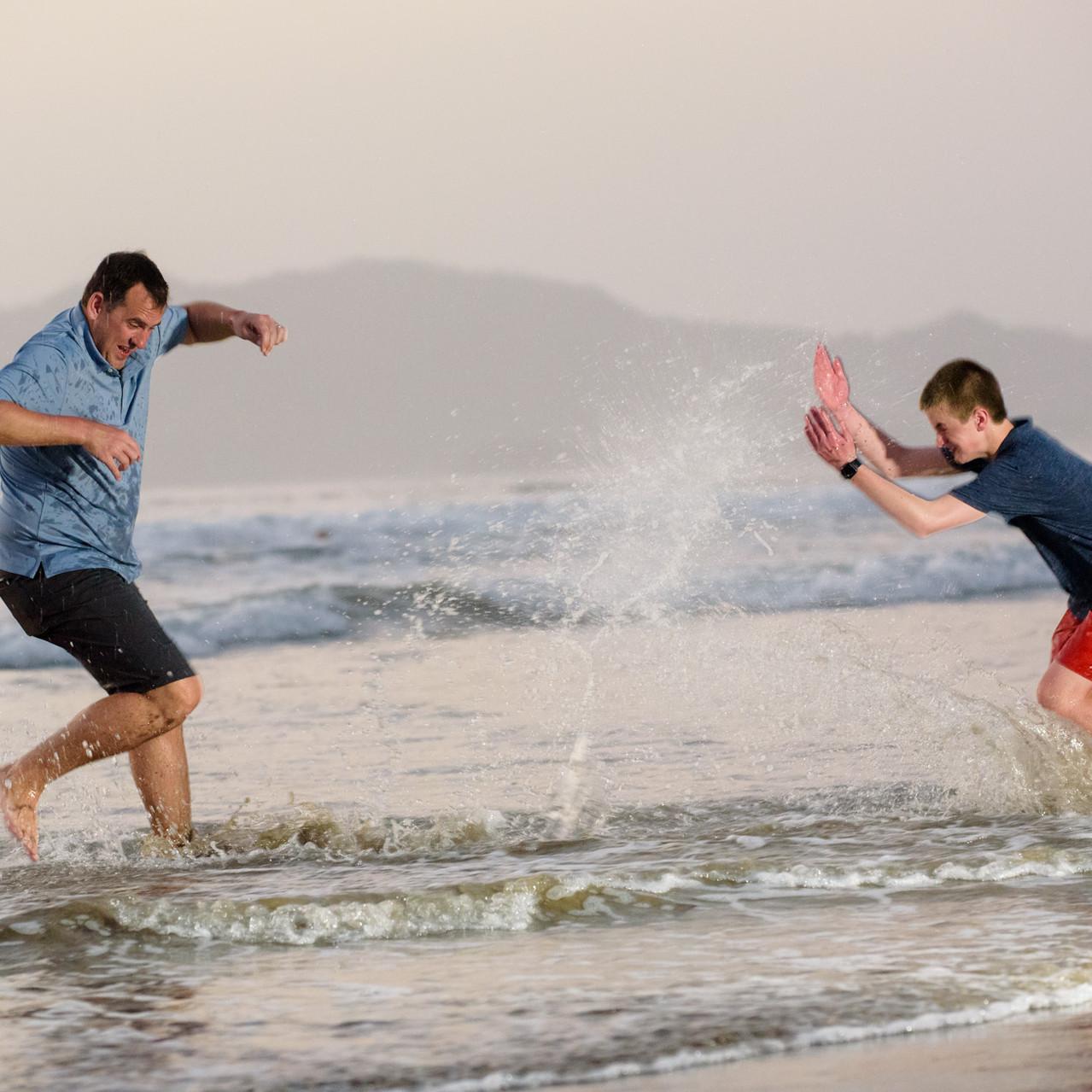 Water wars with dad at Tamarindo Diria