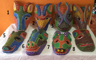 Hand-carved wood mask $700 pesos each (cu) plus shipping (mas envio)