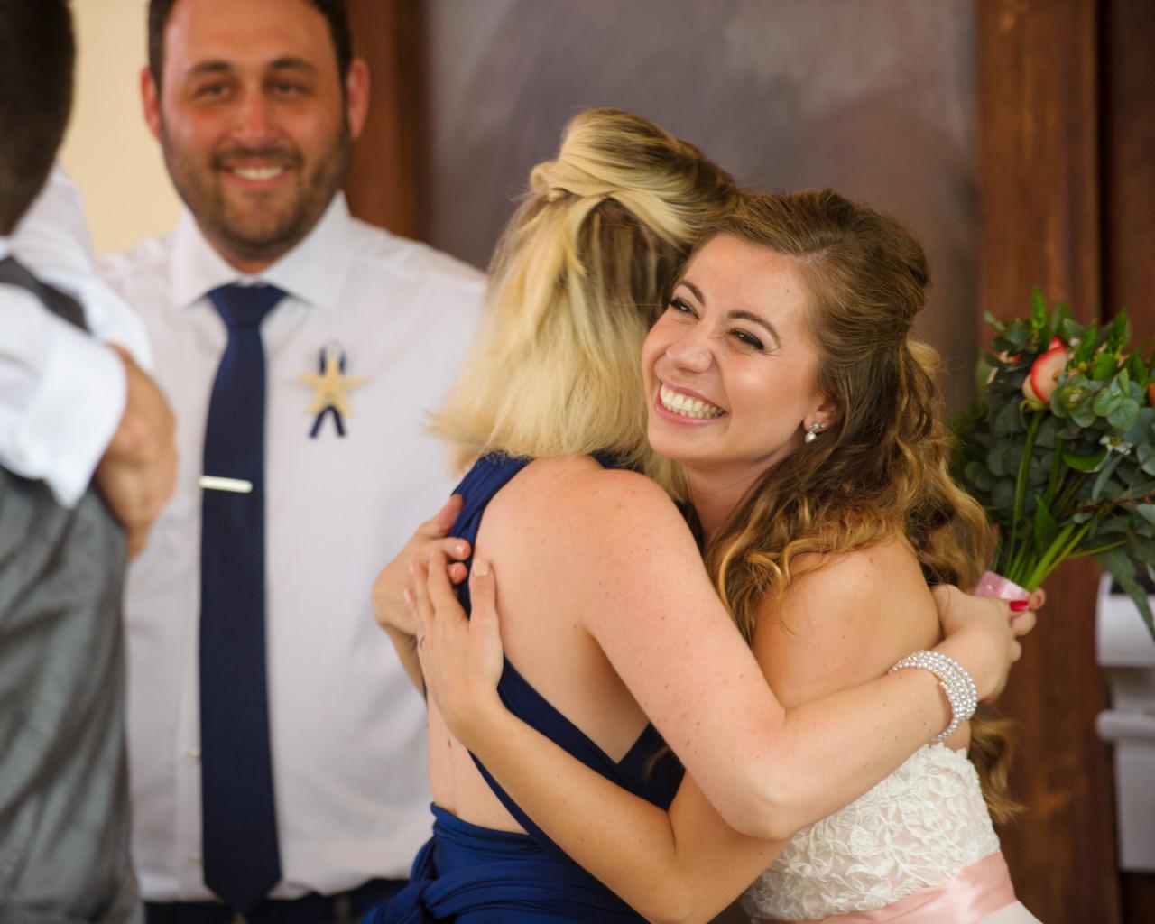 Bride and bridesmaid share a hug at Villa Tranquila in Hacienda Pinilla